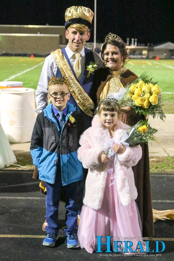2018 Ogemaw Heights Homecoming King and Queen Trevor Likavec and Sophie Courtemanche pose for a photo with Prince and Princess Levi and Mariana Secord.