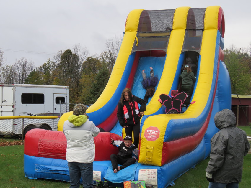 An inflatable slide, obstacle course and bouncy house were at this year's Halloween in the park.