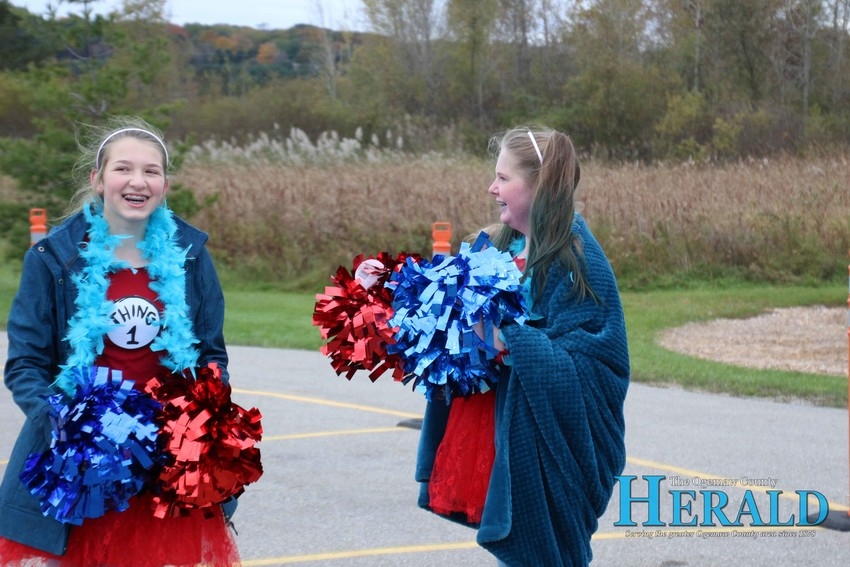 Sarah Thurlow, 13, and Haley Villarreal, 13, cheer on those completing the race.