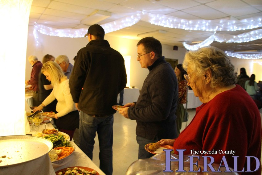 People line up for appetizers during the event.