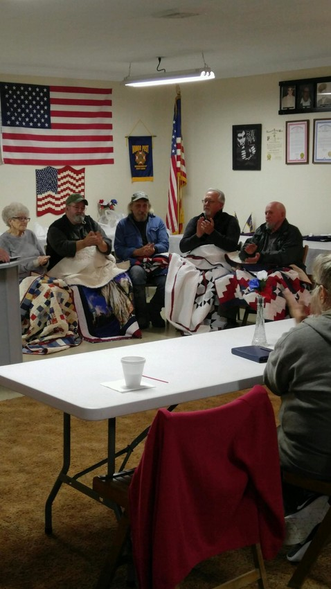 Oscoda County veterans Dorothy Loop, Al Chaney, John Basner, Ron Thomey and Leon Erbe clap after receiving their quilts from members of Quilts of Valor at the VFW Post 4126 Tuesday, Oct. 2.