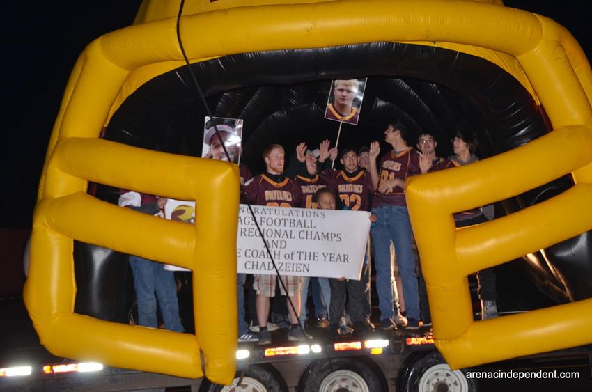 Au Gres-Sims football team celebrate their record setting season.