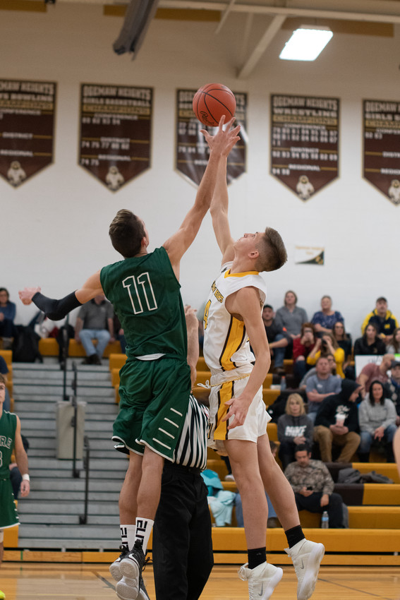 Jacob Rhine battles Kaden Kelly (11) for the opening tip.