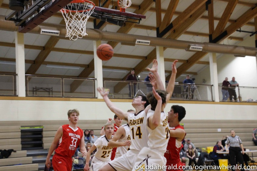 Fairview's Aaron Eaves gets hold of a rebound.