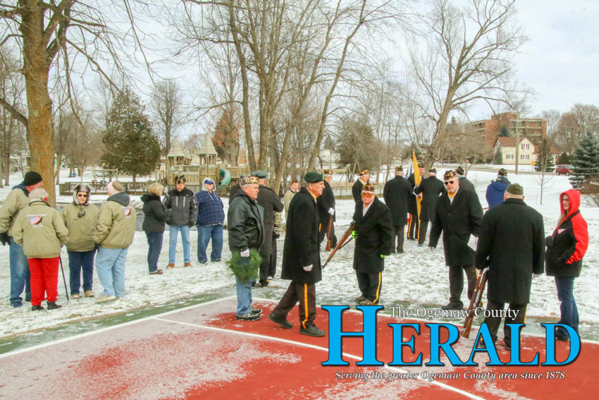 A large crowd gathers at Irons Park in West Branch for the annual Pearl Harbor Day ceremony.