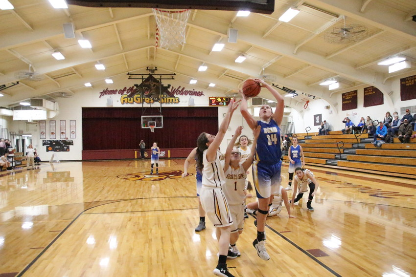 Reagan McGregor goes in for a layup.