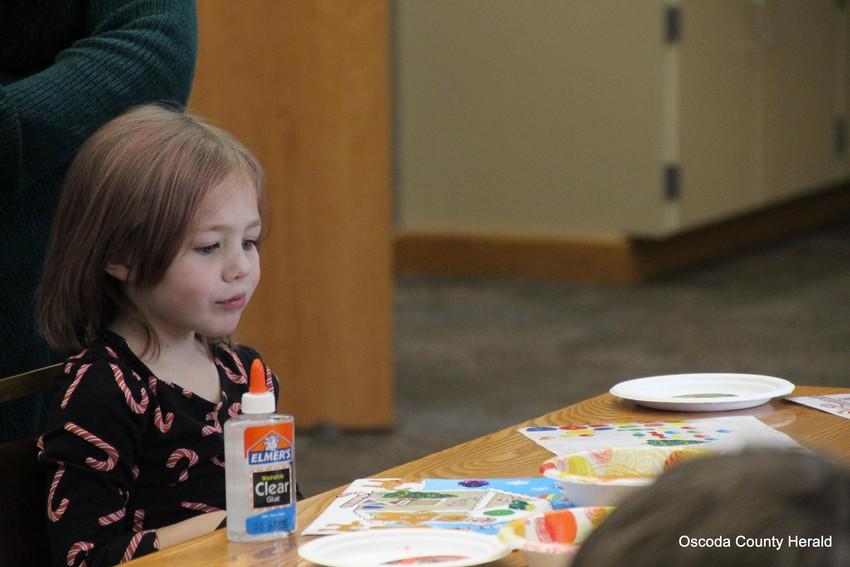 Presley Maclellan looks at her piece of art wondering what else it might need.