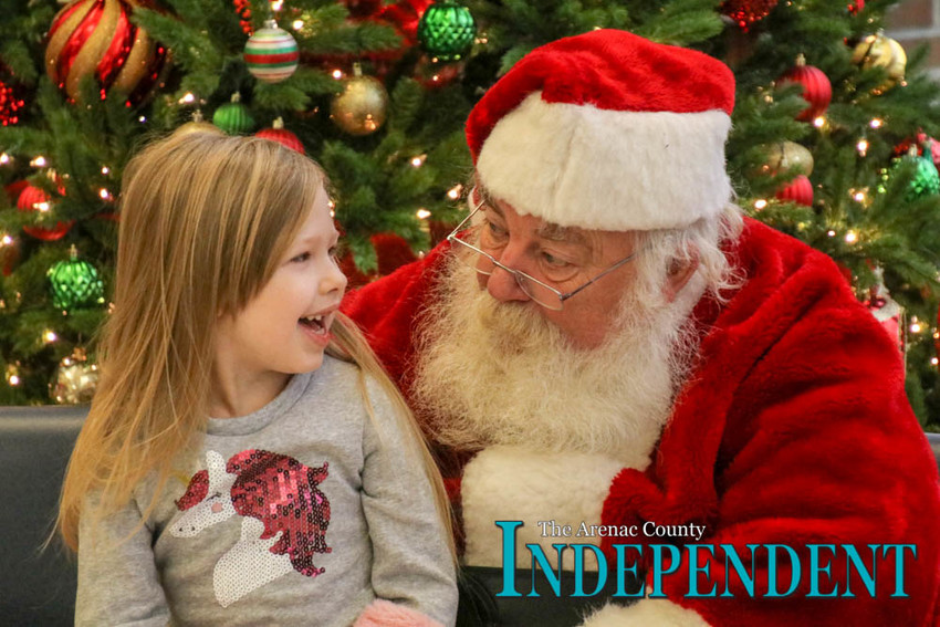 Alana Spencer tells Santa what she wants for Christmas this year.