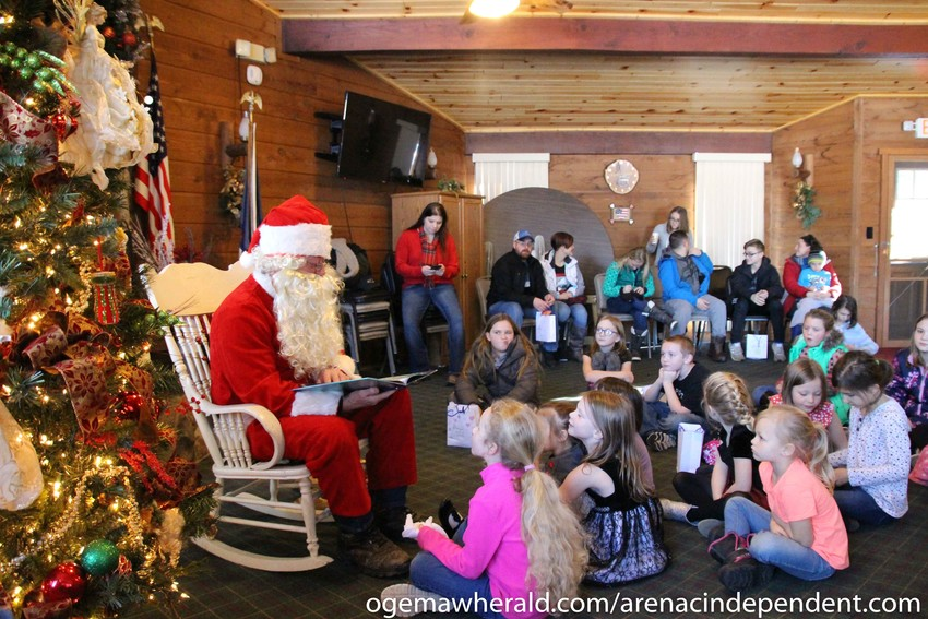 Santa Claus reads to a group of excited children during the  annual Alger Parks and Rec Christmas party at the Forest Lake Clubhouse Saturday, Dec. 8.