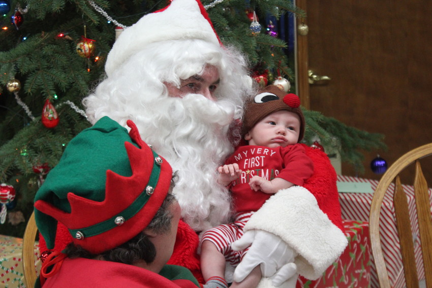 James Wargo, 3 1/2 months, and Santa meet for the first time.