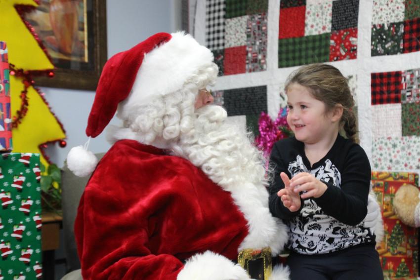 Kaylee Mumaugh, 6, tells Santa what she wants for Christmas Saturday, Dec. 15.