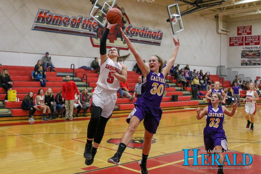 W-P's Laila Bell (5) makes a layup as she blasts into the offensive zone on a steal.
