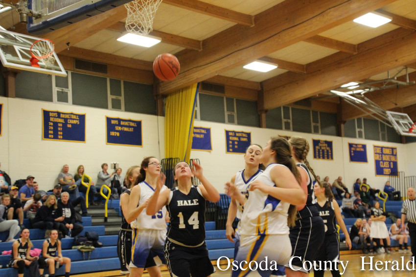 Several Mio girls look on after scoring a basket against Hale.