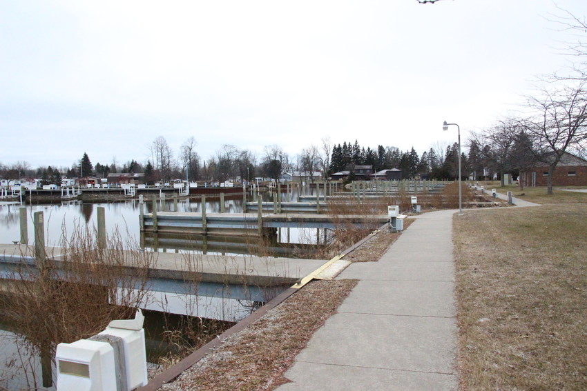 The harbor property, just east of Edmonds' Au Gres Inn and along the river across from Inland Marine Inc., contains an open grass field, some pavement and docks that a few local fishermen already utilize.