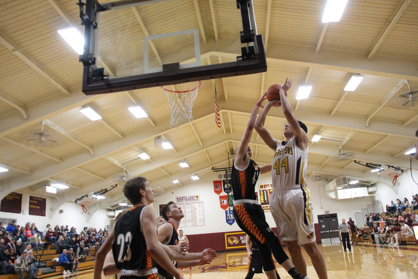 Isaac Beardsley makes a layup.