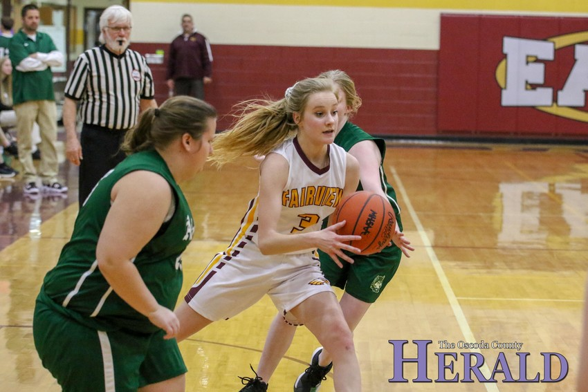 Fairview's Jaedyn Winton (3) slips between a couple Atlanta players on her way to the basket.