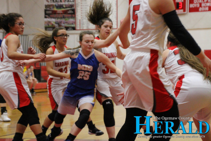 Mio's Jordan Butler attempts to get closer to the ball, despite being cornered by several W-P players.