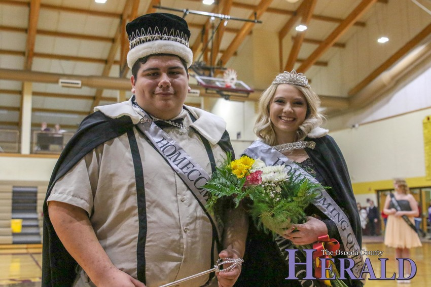 Joshua Hamm and Sydni Kann pose for a photo after being announced as the 2019 Fairview winter homecoming king and queen.