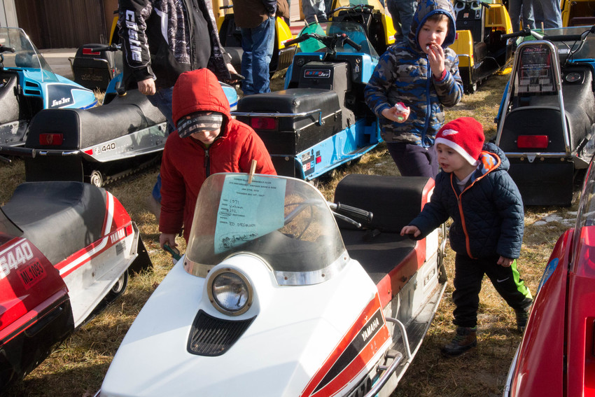 Gavin, 6, Connor, 8, and Braxton, 3, check out a vintage Yamaha sled at last year's show.