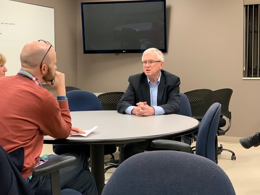 Kirtland Community College President Tom Quinn talks with a small group of community residents about the West Branch campus Tuesday, Jan. 15.