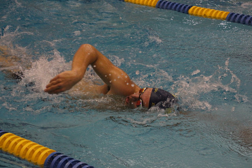 Ethan Levi gets a breath of air as he competes in the 100-yard freestyle.