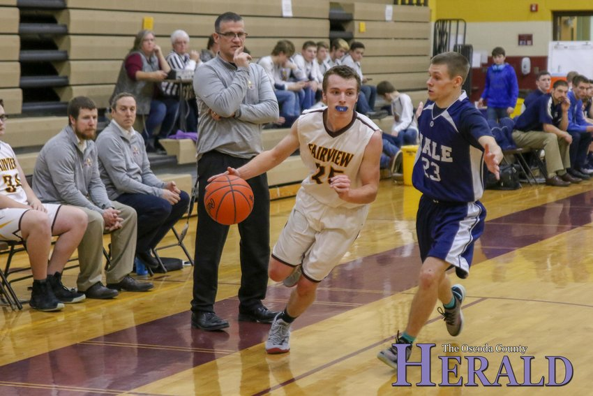 Fairview's Grant Lietzke (25) drives around a Hale defender as he rushes toward the basket.