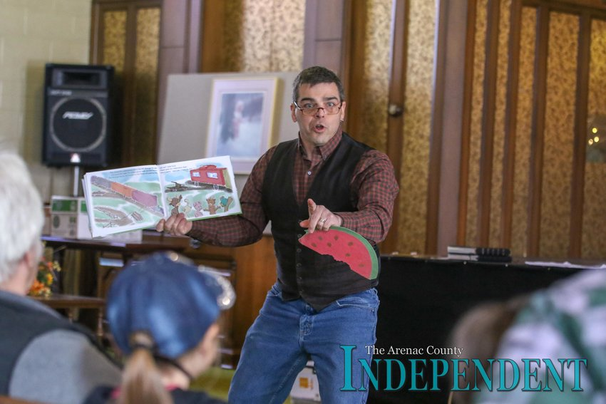 """Kevin White reads his story """"Chasing Watermelons"""" to those in attendance."""