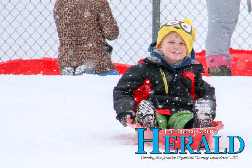 JR Pumphrey, 4, of Rose City takes his turn sledding down the hill.