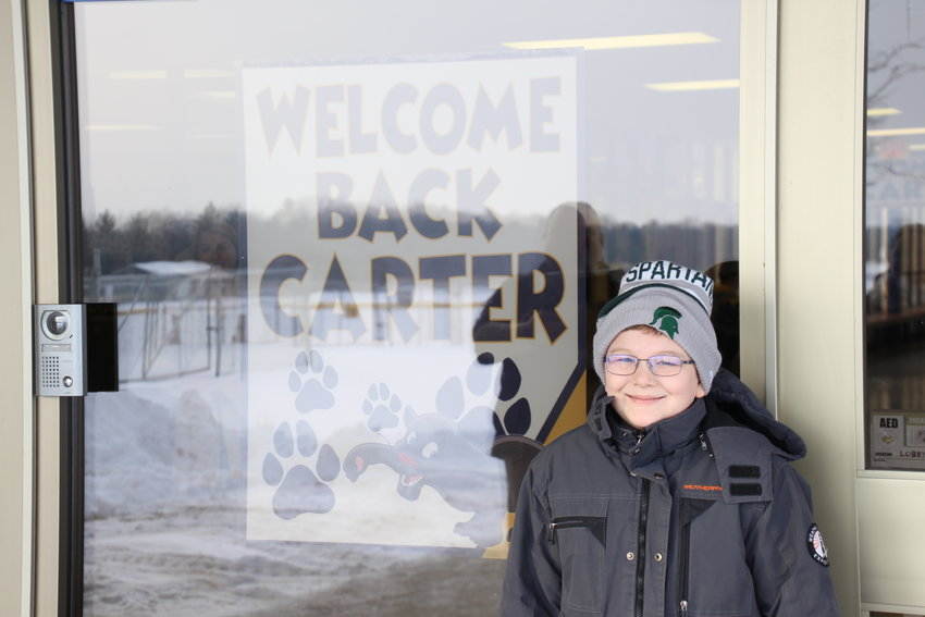 Standish-Sterling Central student Carter Schwab returned to school Feb. 14 after battling cancer for nearly the past year.