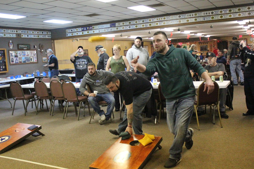Michael Horn of West Branch tosses a cornhole bag.