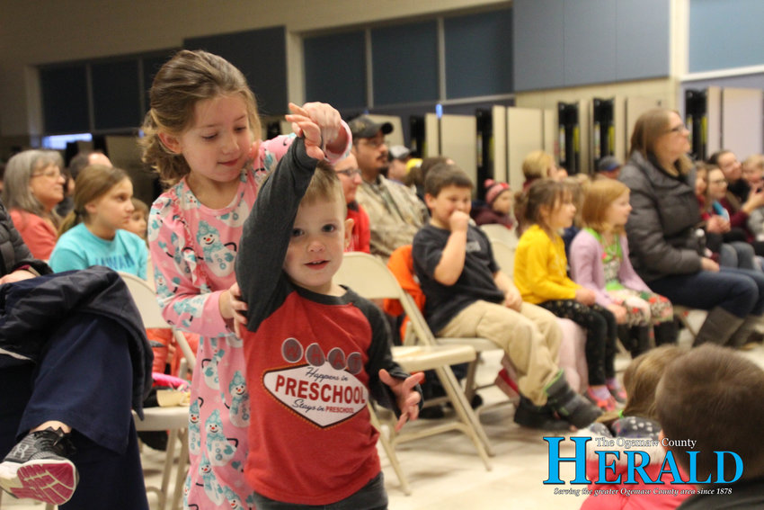 Laken, 5, and Derek Grove, 2, dance to music during the show.