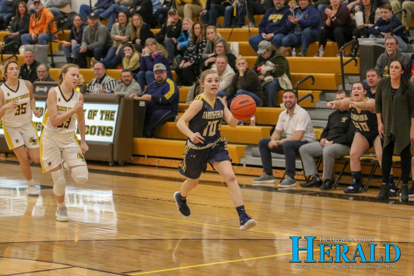 Standish-Sterling's Taylor Stodolak (10) races toward the basket on a breakaway during the district semifinal game at Ogemaw Heights March 6.