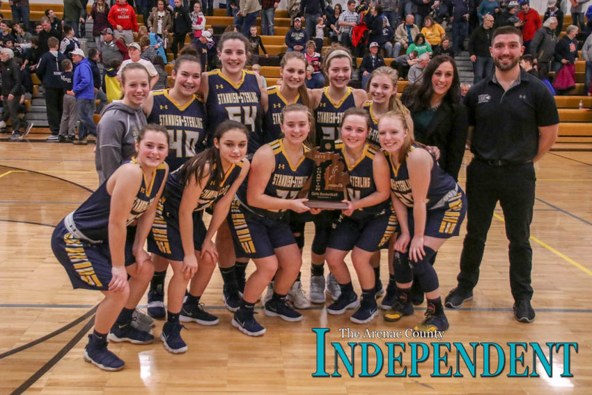 The Lady Panthers pose for a photo after defeating Gladwin for the 2019 district title.