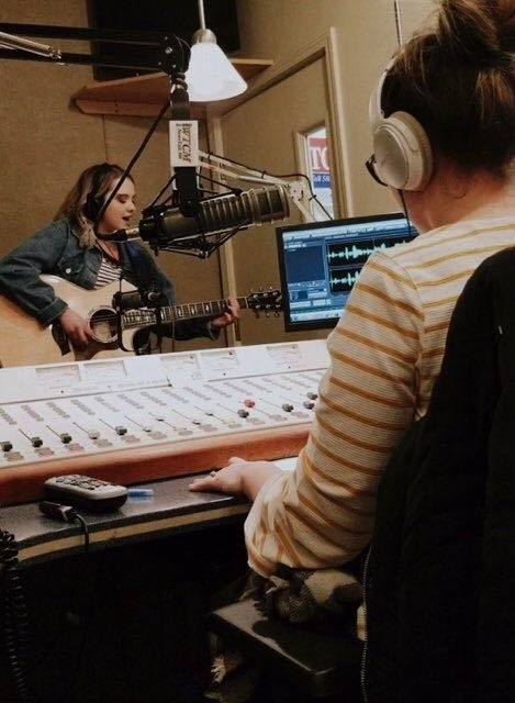 Sydni records one of her songs in a professional studio.