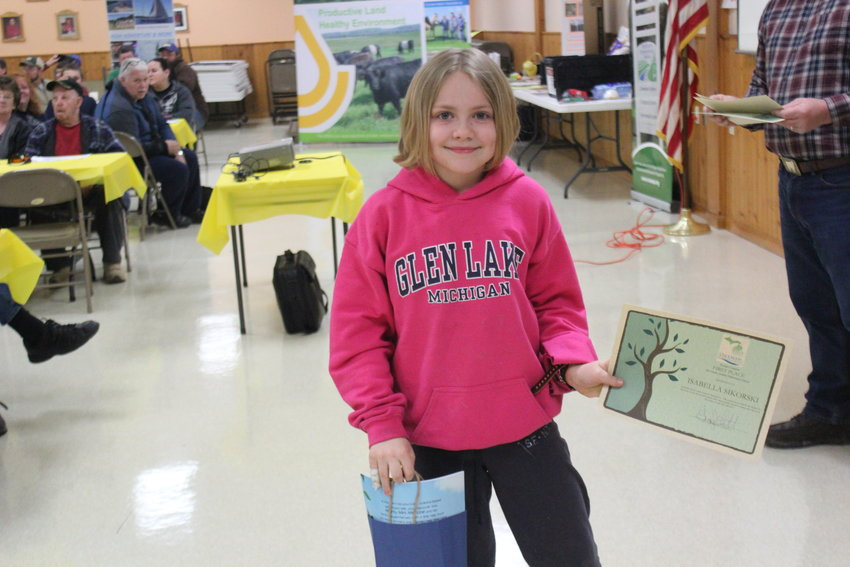 Isabella Sikorski poses with her prize bag and poster.