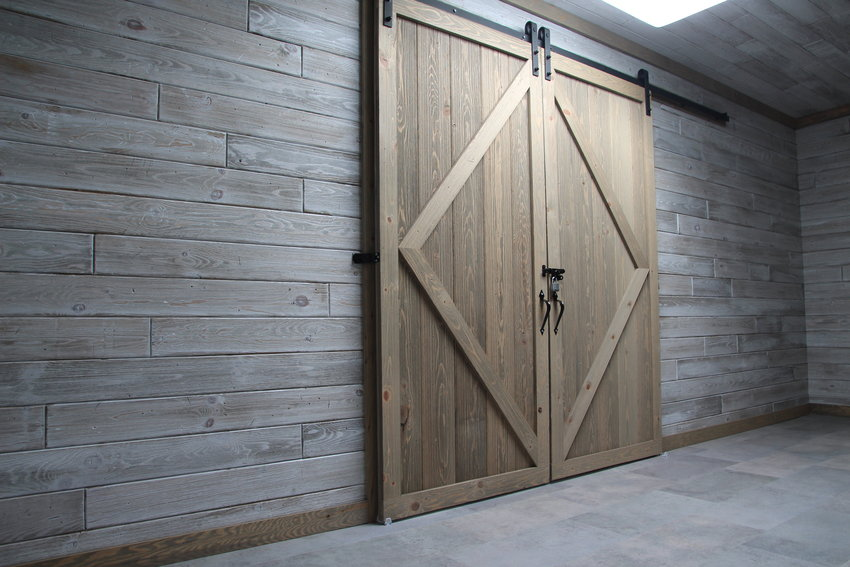 A decorative barn door adorns the wall in the special meeting area.