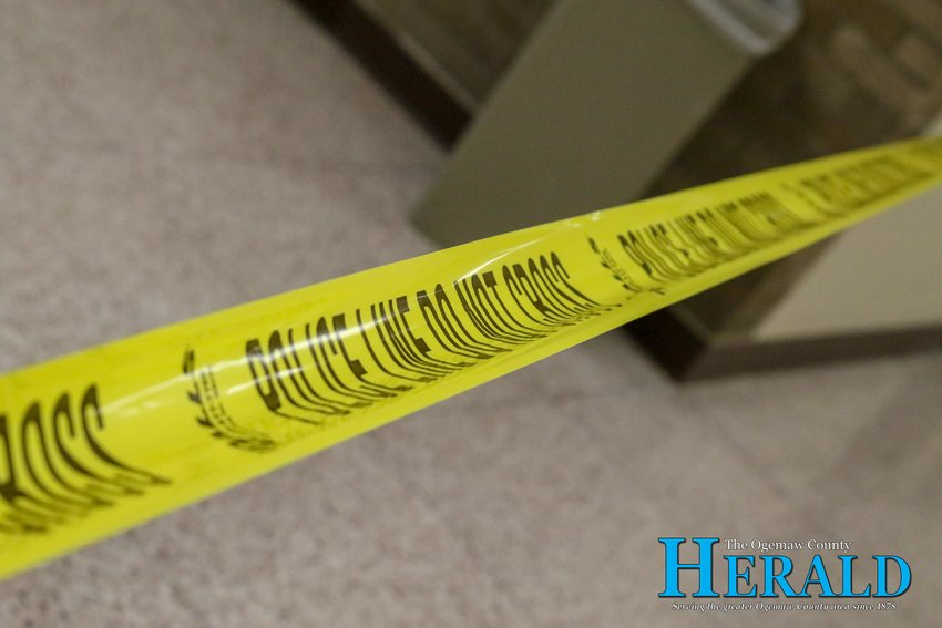 Police tape runs across a hallway blocking off an area for an active shooter training session at Ogemaw Heights High School.
