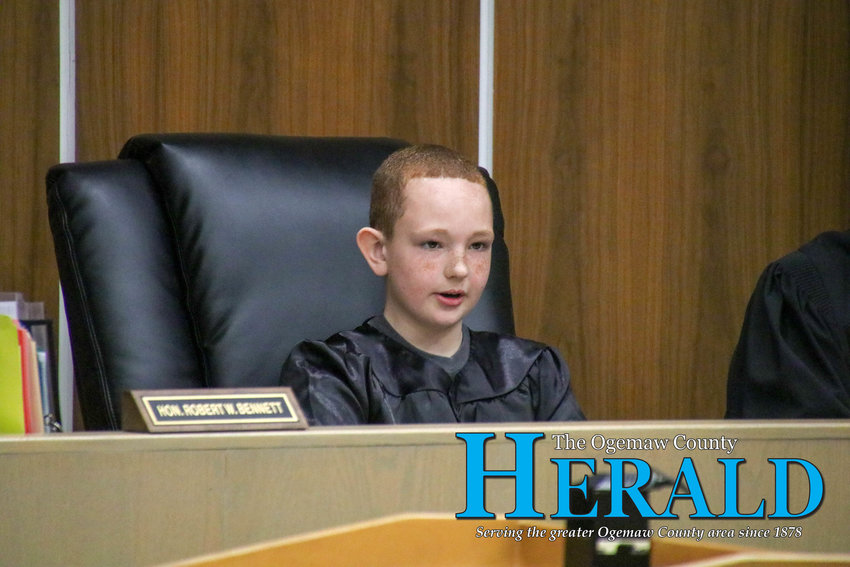 Presiding Judge Jacob Kennedy listens to the prosecution's opening statement.