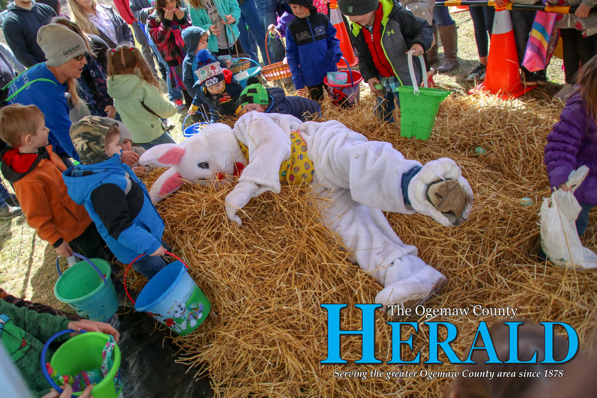 The Easter Bunny dives into the straw pile.