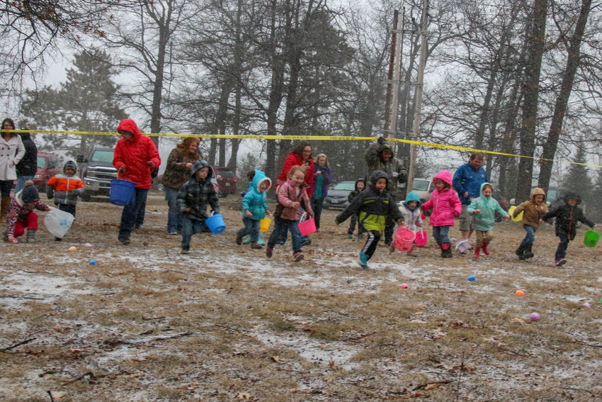 At the sound of a horn the children race to gather eggs at the Oscoda County Park last year.