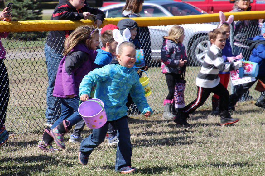 Codie Stawowy, 6, of Sterling gets a running start in this year's egg hunt.
