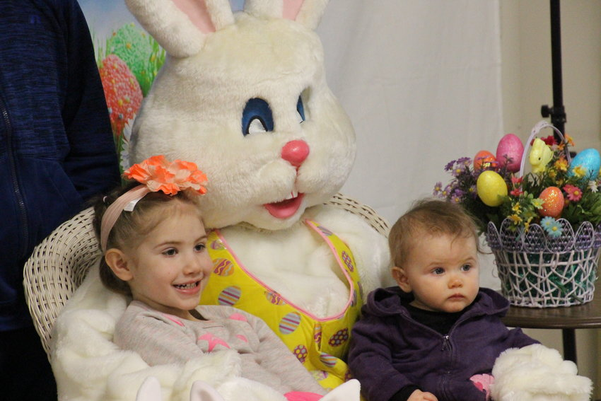 Eliza, 4, and Ezlin, 1, Doran of Sterling pose with the Easter Bunny prior to the hunt.