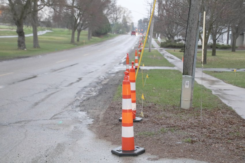 Traffic cones line the side of Fairview Road as the city prepares for major reconstruction on the road starting next week.