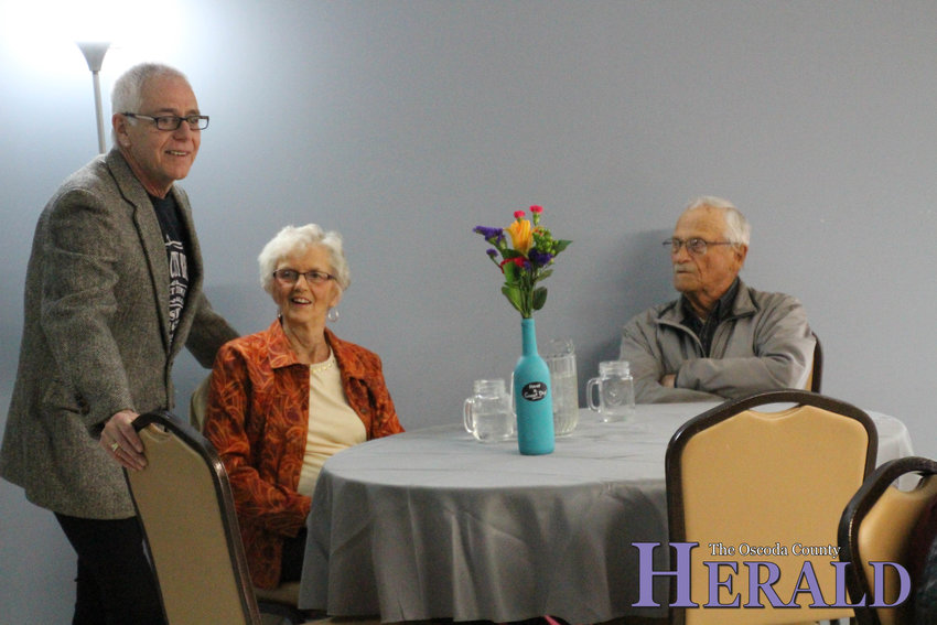 Activities Coordinator Rich Lloyd talks with Margie and Art Beauchesne of Hale at the beginning of the senior prom.