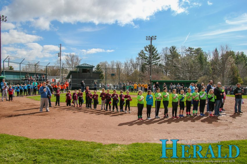Players from a number of teams stand at attention during the singing of the national anthem.