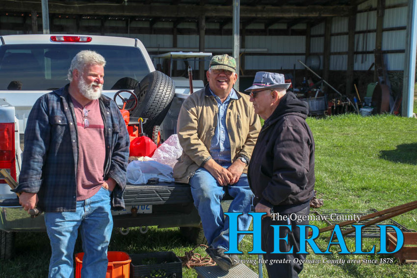 Mike Perry of Flint, Mike Schultz of Saginaw and Delbert Burtch of West Branch visit during the swap meet.