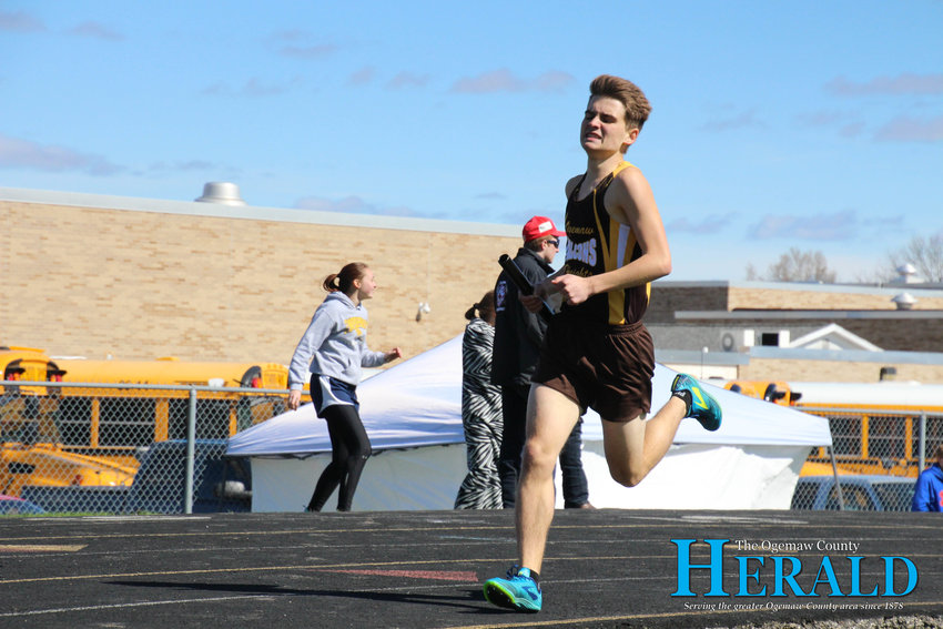 Ogemaw Heights' Colton Bragg keeps a serious face while running one of the races.