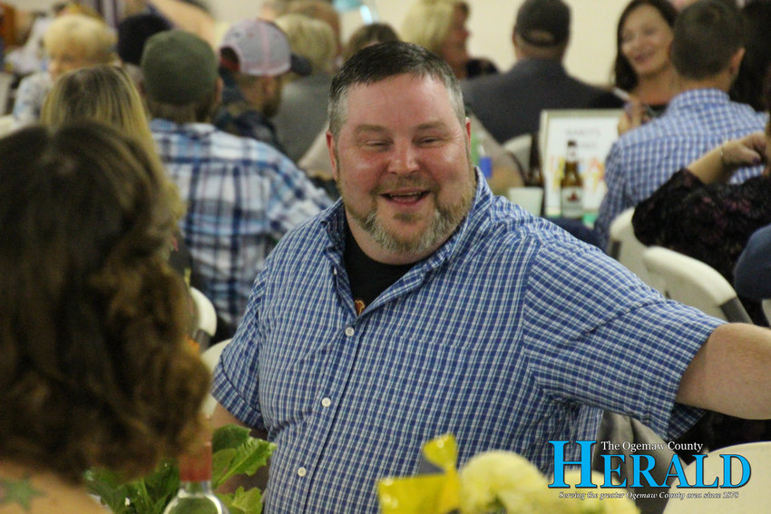 Mike Machado of Skidway Lake smiles while having a conversation during the event.