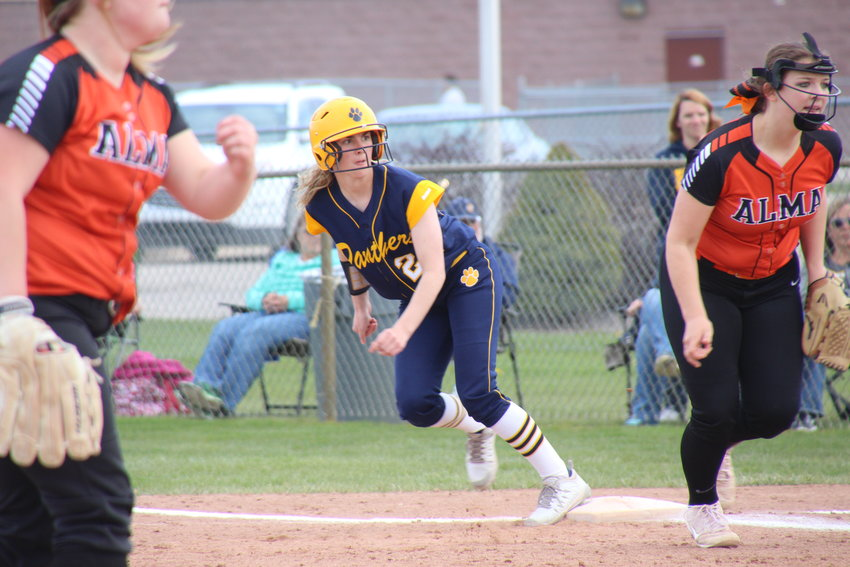 Madyson Ahleman leads off the bag as the ball is put into play.