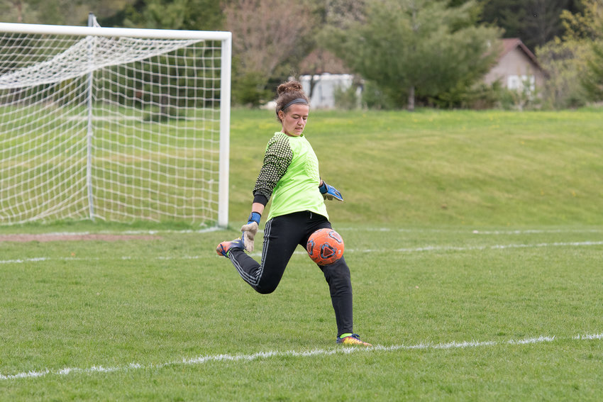 Falcon keeper Rowan Peace boots the ball away from the Ogemaw goal.